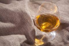 Brandy on sackcloth Stock Image