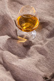Brandy on sackcloth Royalty Free Stock Image