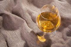 Brandy on sackcloth Royalty Free Stock Photo