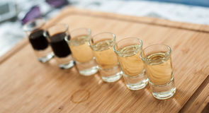 Brandy in shot glasses lined up in a row Stock Photo