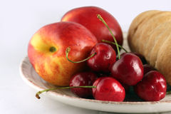 Brandy snap, nectarine and cherry Royalty Free Stock Photos