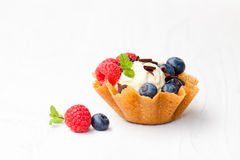 Brandy  snaps basket with ice cream and berries on white backgro Stock Photos