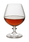 Brandy. Snifter of aged brandy isolated on white Stock Image