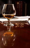Brandy snifter desk paperword Royalty Free Stock Image