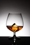 Brandy Snifter With Ice Cube Royalty Free Stock Images