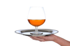 Brandy Snifter on tray held by wonams hand Stock Photo