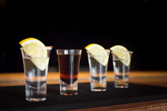 Brandy and  three tequila shots with lemon Royalty Free Stock Image