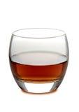 Brandy in vetro su fondo bianco Immagini Stock
