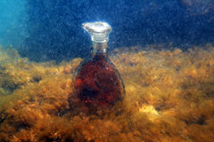 Brandy on water. Royalty Free Stock Photos