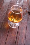 Brandy on wood Stock Images