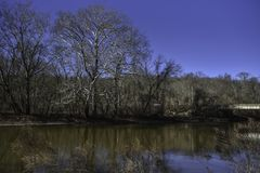 Brandywine Creek in Wilmington, Delaware. With a bright blue sky and reflections in the water stock images