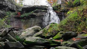 Brandywine Falls. In Cuyahoga Valley National Park Ohio. A gorgeous 65 foot falls seen here in autumn from the creek level showing the massive boulders in front stock video footage