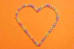 Branelli di plastica sotto forma di un cuore Fotografia Stock Libera da Diritti