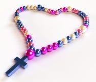 Branelli variopinti astratti del rosario su bianco Fotografia Stock