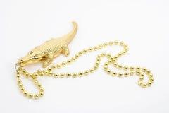 Branello del coccodrillo dell'oro Fotografia Stock