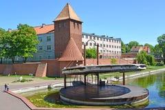 BRANIEWO, POLEN Eine Ansicht einer Turnhalle der Jesuite, eine Verstärkung mit Türmen und eine Szene auf Wasser Stockbilder