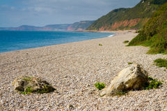 Branscombe beach Devon. Branscombe beach in Devon looking towards Sidmouth. It is located within the East Devon Area of Outstanding Natural Beauty,  It is part Stock Image