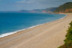 Branscombe beach Devon. Branscombe beach in Devon looking towards Sidmouth. It is located within the East Devon Area of Outstanding Natural Beauty,  It is part Stock Images