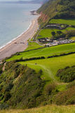 Branscombe beach in Devon. Branscombe in Devon viewed from the stunning South-West costal path.  It is located within the East Devon Area of Outstanding Natural Royalty Free Stock Photography