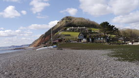 Branscombe England. The shingle beach and tea rooms of the  pretty village of Branscombe in East Devon  England Royalty Free Stock Images