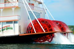 The Branson Belle Showboat. Close up of the red paddle wheels of the Branson Belle Showboat as it leaves dock on Table Rock Lake in Branson, Mo. Riverboat rides royalty free stock photos