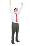 Braços aumentados comemorando o grito do trabalhador de escritório do Latino Foto de Stock