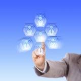Bras assemblant un travail Team In Cyberspace Image libre de droits