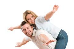 Bras de sourire heureux de ferroutage de couples tendus Photos stock