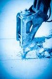 Bras hydraulique avec le rupteur d'incidence images libres de droits