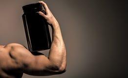 Bras musculaire Muscles forts Sportif, muscles, homme d'athlète, triceps Bras intense Stéroïde, vitamine de sport, enduisant photographie stock libre de droits