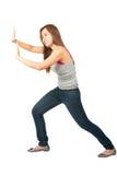 Bras prolongés de femme poussant contre l'objet latéral Photos stock