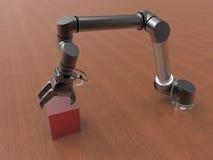 Bras robotique sélectionnant un cube Photo stock