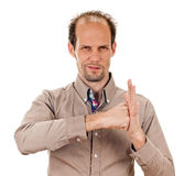 Bras sorti de poing serré par jeune homme audacieux Photo libre de droits