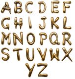 Brash mettalic alphabet. Golden colored Metallic embossed English capital alphabets from a to z Royalty Free Stock Images