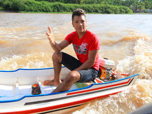 Brazil: Boy in a Motor Boat Royalty Free Stock Images