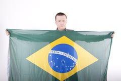 Brasil fan. Man holding flag of Brasil Royalty Free Stock Image
