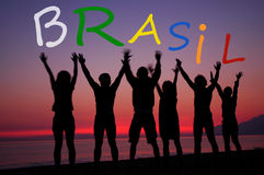 Brasil, fans holding letters on the beach. Brasil, people holding letters on the beach Royalty Free Stock Image