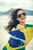 BRasil flag woman fan. Latino woman with Brasil flag laughing and smiling in support of Brazilian soccer fan stock photography