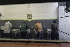 Brasil - San Paolo - The ONG Sermig - the dormitory bathrooms. Sermig is a catholic organization that work in San Paolo to help homeless and poor people stock images