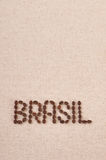 Brasil written with coffee beans on canvas. Background Stock Images