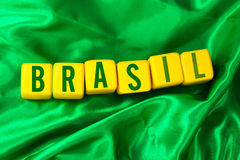 Brasil written on yellow cube on green background Royalty Free Stock Images