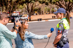 Brasilia, Brazil-August 4, 2016: Brazilian Police being Interviewed. Brazilian Police being Interviewed by Local Press at the 2016 Rio Olympic Games Outside the Royalty Free Stock Photography