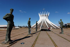 Brasilia Cathedral Brazil. The curved lines of the Cathedral of Brasilia and four statues of the apostles Stock Image