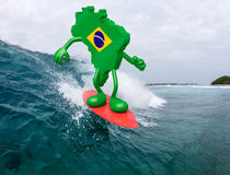 Brasilian map with arms and legs on surf board Royalty Free Stock Photo