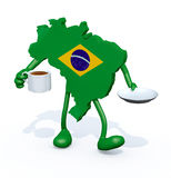 Brasilian map with cup of coffee on hand Royalty Free Stock Photography