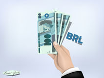 Brasilian reals money paper on hand,cash on hand Royalty Free Stock Photos