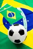 Brasiliansk flagga och fotboll Royaltyfria Bilder