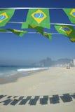 Brasiliansk flagga som Bunting den Ipanema stranden Rio Brazil Fotografering för Bildbyråer