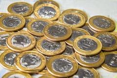 Brasiliansk valuta - verkliga mynt ett Royaltyfri Bild