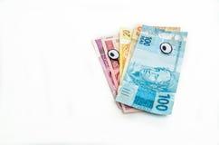 Brasilianska pengar för anmärkningar som till vänster ser Arkivbilder